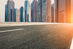 The modern urban commercial building and asphalt road Stock Photos
