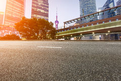 The modern urban commercial building and asphalt road Royalty Free Stock Photography