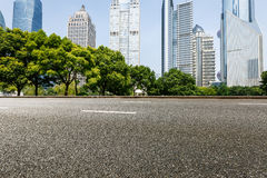 The modern urban commercial building and asphalt road Stock Images
