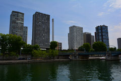 Modern urban Paris view: tall skyscrapers by the river Seine Royalty Free Stock Photos