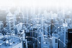 Modern urban skyline with high-speed data and internet communication network. Concept of cyber network in big city with copy space stock images