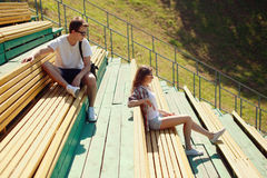 Modern urban young couple in the park, youth, love, dating. Modern urban young couple in the city park, youth, love, dating, students - concept Stock Images