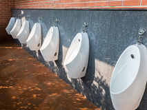 Modern urinals row. Stock Photo