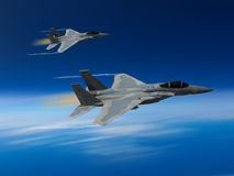 Modern US fighter plane. Computer Illustration - Modern US style jet fighters at high altitlutde in fast flight. Blurred motion background Royalty Free Stock Image