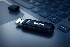Modern USB Flash drive on laptop keyboard Stock Images