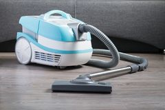 Modern vacuum cleaner with the function of dry and wet cleaning royalty free stock photos