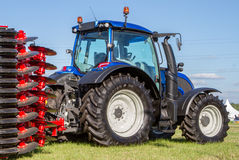 Modern Valtra tractor with cultivator Royalty Free Stock Photos