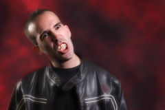 Modern Vampire. A modern day vampire is baring his teeth because he is thirsty for blood Royalty Free Stock Photo