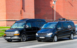 Modern vans. MOSCOW, RUSSIA - MAY 5, 2012: Modern vans Chevrolet Express and Mercedes-Benz W639 Viano  in the city street Royalty Free Stock Images