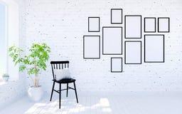 Modern vardagsruminre för vit tegelsten med ramar för bosatt utrymme och fotopå väggen Arkivbild
