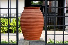 Wall, luxuriant decoration. Modern Vase outside of modern home Stock Photo