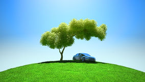 Modern vehicle under tree on green fileld Royalty Free Stock Photography
