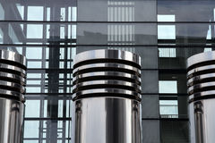 Modern Ventilation Pipes and High-R. Modern Ventilation Pipes in Front of Modern High-Rise Stock Images