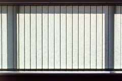 Modern vertical blinds on the window. Of the office Stock Image