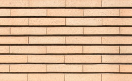 Modern vibrant yellow brick wall as a background image Royalty Free Stock Photography