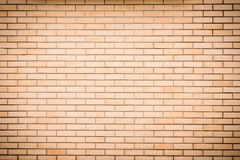 Modern vibrant yellow brick wall as a background image Stock Image