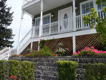 Modern Victorian style townhouse building. White wooden rails and nice landscaping Stock Images