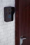 Modern Video Intercom near Door Stock Image