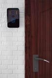 Modern Video Intercom near Door Royalty Free Stock Photos