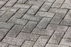 Modern view of monotone gray brick stone on the ground for street road. stock images
