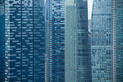 Modern view of the office buildings. Multitude windows of the office skyscrapers Royalty Free Stock Photo