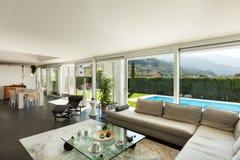 Modern villa, beautiful interiors. Modern villa, interior, beautiful living room Royalty Free Stock Photo