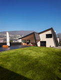 Modern villa, exterior with lawn, nobody Royalty Free Stock Images