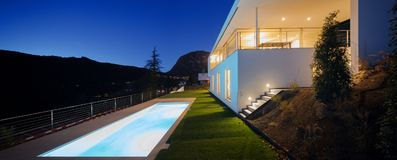 Modern villa, exterior in the night, lights on royalty free stock photos