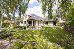 Modern villa housefront in the garden Stock Photo