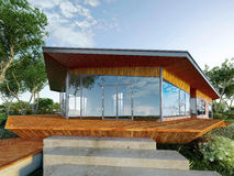 Modern villa made of wood and steel, with green park around. On a large wood platform Stock Photography