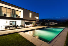 Modern villa, night scene. View from poolside stock image