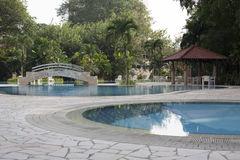 Modern villa outdoor with swimming pool and gazebo Royalty Free Stock Photo