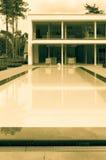 Modern villa in sepia. A modern villa with swimming pool Stock Image