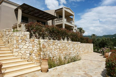 Modern villa with a terrace and blue sky in Greece. Stock Photos