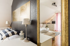 Modern villa with two spacious bedrooms. New bedroom with glitter black wall open to a spacious, light bedroom with white furniture stock images