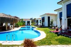 Modern villas with swimming pool at luxury hotel. Antalya, Turkey Stock Photo