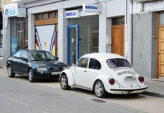 Modern and vintage cars parked in the street Stock Images