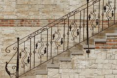 Modern Vintage Style Stone Staircase With  Wrought Iron Ornate H Stock Image
