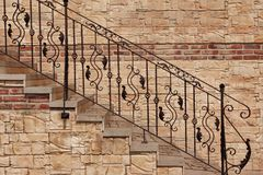 Modern Vintage Style Stone Staircase With Wrought Iron Ornate H royalty free stock photo