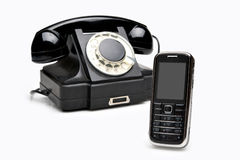 Modern and vintage telephones. Retro classics and modern cellular phones isolated over white background Royalty Free Stock Images
