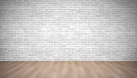 Modern vintage white brick wall on brown plank wood floor wiht l Royalty Free Stock Photo