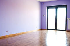 Modern violet room. Interior of empty modern violet room with wooden laminate floor Stock Images