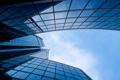 Modern and visionary skyscraper with many windows and reflection. S and blue sky royalty free stock image