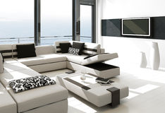 Modern vit vardagsruminre med storartad seascapesikt Royaltyfri Bild