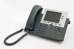 Modern VOIP telephone on white. Modern two channel VOIP telephone isolated on white background Royalty Free Stock Photo