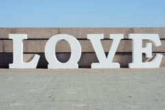 Modern volumetric white letters design on love featuring 3d typography Royalty Free Stock Photo