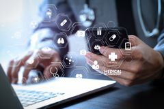 Close up of smart medical doctor working with mobile phone and l. Modern VR with medical technology diagram concept.close up of smart medical doctor working with Royalty Free Stock Images