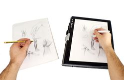 Modern vs Traditional. Two hands drawing, one on usual paper describing traditional way and other with stylus on tablet pc Royalty Free Stock Photography