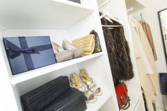 Modern walk in closet with luxury shoes and bags. Shopping beauty stock photos