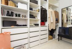 Modern walk in closet with luxury shoes and bags. Shopping beauty stock image